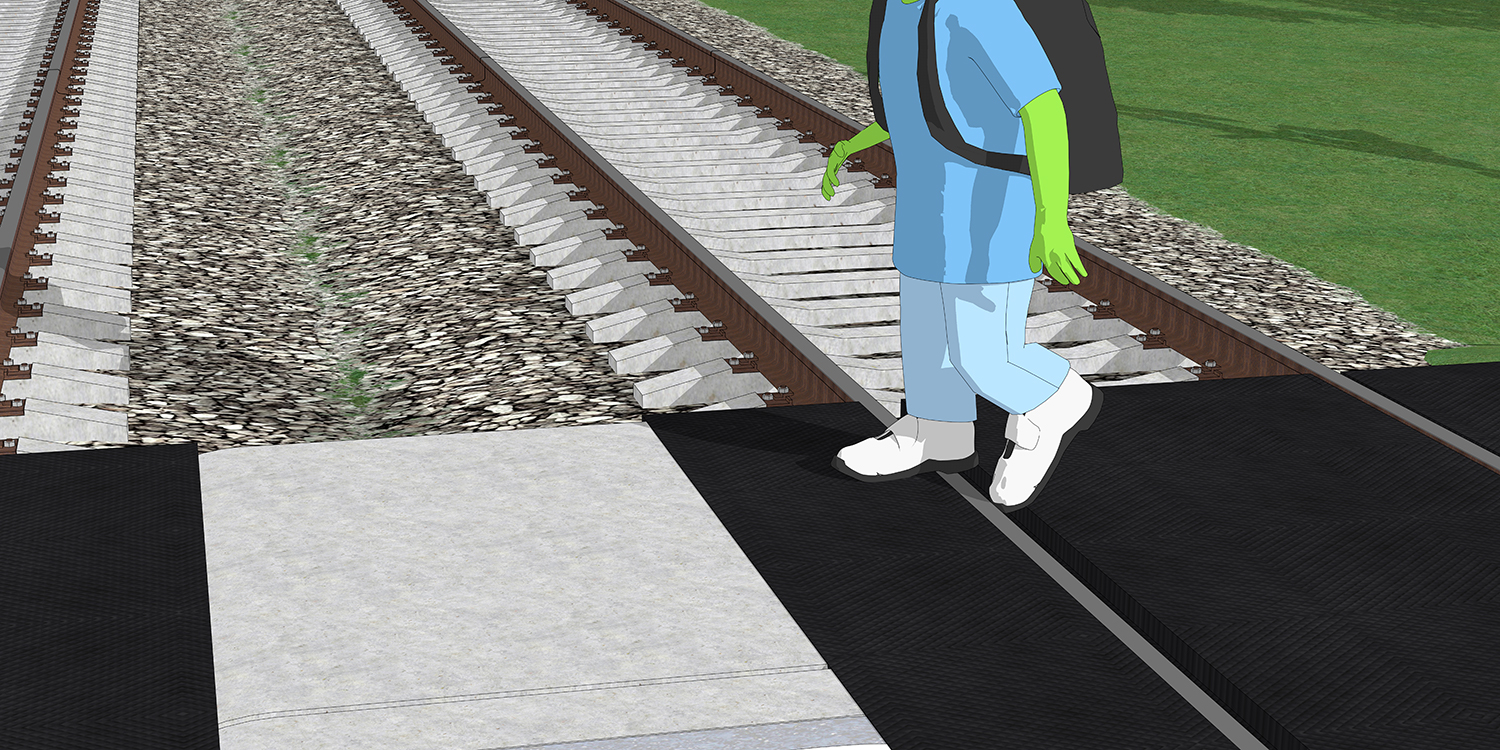 A closeup of how a shoe can get stuck in the gap between the road and the rails