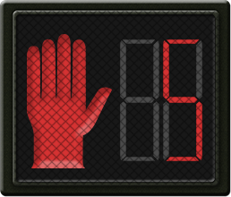 A pedestrian signal with a flashing red hand and a countdown